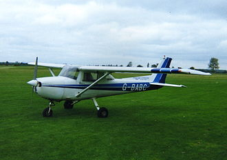 Little Gransden Airfield - A Reims Cessna 150, formerly used by Skyline School of Flying, parked next to the hangars