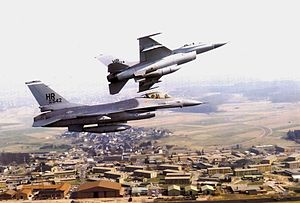 Hahn Air Base - General Dynamics F-16A Block 15 Fighting Falcons of the 50th Tactical Fighter Wing over Hahn Air Base.  AF Ser. No. 80-0542 is visible in front