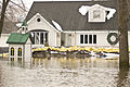 FEMA - 40371 - Home protected from flood waters by sand bags in Minnesota.jpg