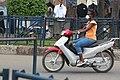 Femme au volant d'une moto.jpg