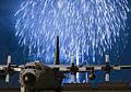 Fireworks explode behind a C-130 Hercules at Yokota Air Base, Japan (3).jpg