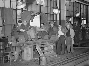 Flint sit-down strike - Sit-down strikers guarding window entrance to Fisher body plant number three. Photo by Sheldon Dick, 1937.