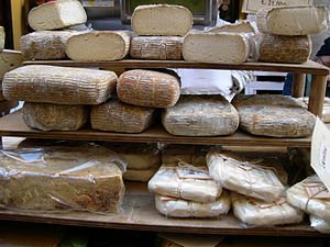 History of cheese - Cheese in a market in Italy