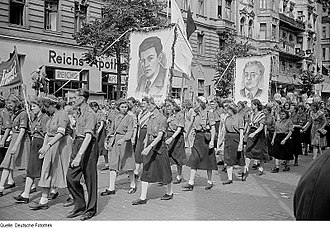 Enrico Berlinguer - Free German Youth parade with Berlinguer's portrait, 1951