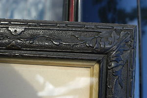 Coulter, South Lanarkshire - Detail of the picture frame made from oak tree found six foot underground in an avenue, Coulter, in 1859.