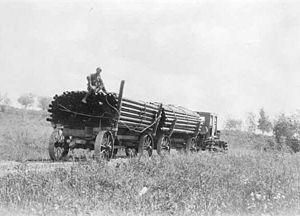Alaska Road Commission - Tractor hauling wagons on Yukon Highway near Goldstream. 1928