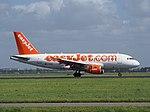 G-EZAX easyJet Airbus A319-111 landing at Schiphol (EHAM-AMS) runway 18R pic3.JPG