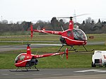 G-JKAT Robinson 22 With G-JKHT Robinson R22 Two Helicopters (46273565455).jpg