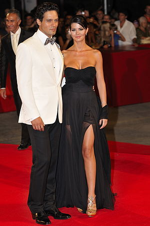 Red carpet fashion - Italian actors Gabriel Garko (in black tie) and Laura Torrisi on the red-carpet at Venice Film Festival, 2009