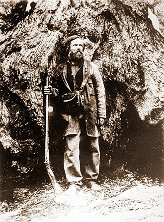 History of the Yosemite area - Galen Clark, the first guardian of Yosemite Valley and the Mariposa Grove, pictured in front of the Grizzly Giant Tree, Mariposa Grove around 1858-9.