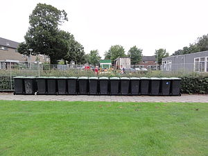 English: Garbage bins in a row, during prepara...