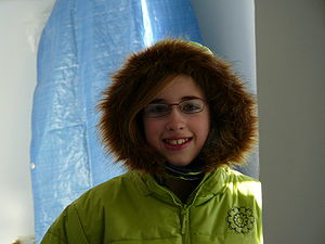 Girl wearing a parka with fake fur