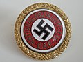 Golden Nazi Party Membership Badge allegedly presented to Eva Braun and signed by Adolf Hitler adverse front Swastika. Nazi memorabila from the collecetions of David Gainsborough-Roberts.jpg