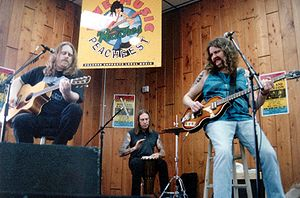 Gov't Mule - The original lineup of Gov't Mule performs an acoustic set at a record store in Fort Lauderdale, Florida.  From left: Warren Haynes, Matt Abts and Allen Woody.