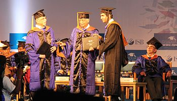 Student Receiving Academic Degree From Azim Premji During A Graduation Ceremony In ISB Adi Godrej The Background Recipient And Donors Convocation