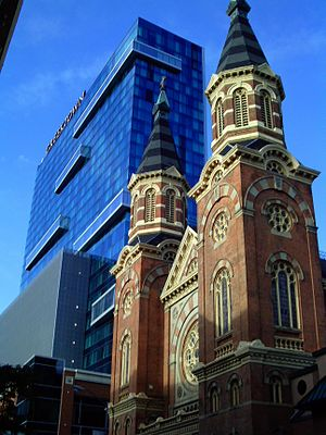 Greektown, Detroit - Greektown Casino Hotel with St. Mary's Church in the foreground