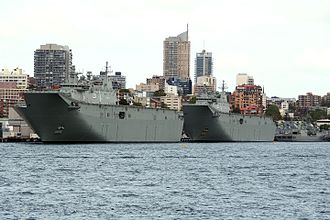 Canberra-class landing helicopter dock - HMAS Adelaide and HMAS Canberra berthed at Fleet Base East taken from Fort Denison in January 2016