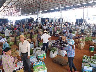 Wholesale marketing of food - Haikou wholesale vegetable market, China.