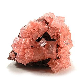 Pink cubic halite (NaCl; halide class) crystals on a nahcolite matrix (NaHCO3; a carbonate, and mineral form of sodium bicarbonate, used as baking soda). Halite-Nahcolite-51411.jpg