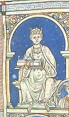 An image of King Henry II, portraying him in all white on a blue background.  King Henry is sitting, holding a church.  He has a royal crown on his head.