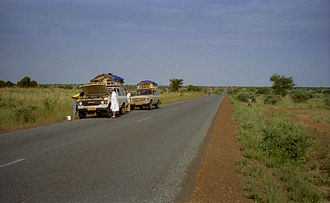 "Transport in Niger - Two tourist vehicles stop for repairs on the main Niamey - Tahoua ""Route Nationale"", 1997."