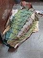 Hobo man sleeping in a Railway Station Ticket Counter.jpg