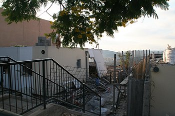 House in Maalot hit by Katyusha.jpg