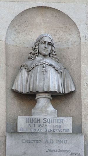 "South Molton - Stone bust of Hugh Squier (1625-1710), within an aedicule on facade of South Molton Town Hall. Inscribed on plinths: ""Hugh Squier AD 1625-1710. Our great benefactor. Erected AD 1910, James Sanders, Mayor"""