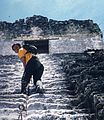 IClimbing one of the Maya pyramids of Tikal.jpg
