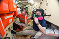 ISS-42 Terry Virts and Samantha Cristoforetti with emergency training exercises in the Rassvet module.jpg