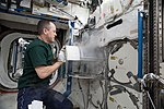 ISS-55 Ricky Arnold transfers frozen biological samples from the Destiny lab.jpg