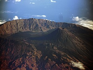 Somma volcano - Aerial view of Fogo Island, Cape Verde, an example of a somma volcano. The volcanic cone Pico do Fogo rises 100m above the walls of the caldera.