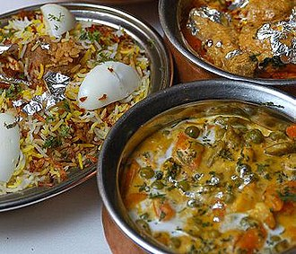 Biryani - Hyderabadi Biryani (left) served with other Indian dishes.