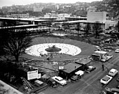International Fountain, a large public water fountain, shown under construction in Seattle in 1962. The fountain was one of the centerpieces of the Century 21 Exposition, held in Seattle in 1962. In the photograph, the white rocks surrounding the center of the fountain have not been fully installed.
