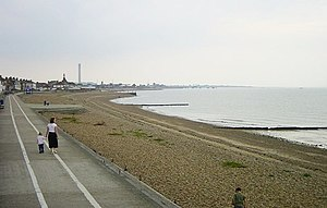 Sheerness - Sheerness beach with the chimney of the Grain Power Station in the distance
