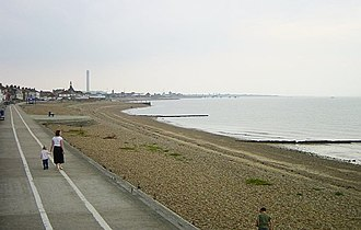 Sheerness - Sheerness beach with the chimney of the Grain Power Station in the distance (since demolished in 2016).