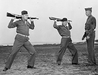 James J. Braddock - Braddock (left) and Joe Gould (center), training as officers at the Atlantic Coast Transportation Corps Officers Training School in Fort Slocum, New York