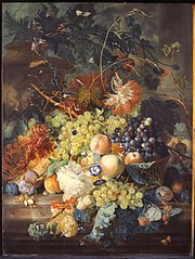 Still life of fruit heaped in a basket, next to an urn