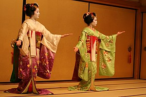 Two maiko performing in Gion.