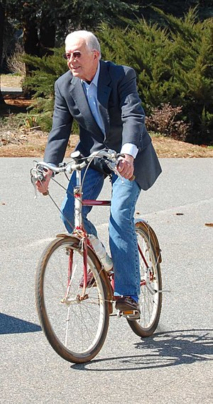 Jimmy Carter on bicycle.