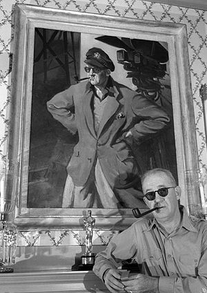 John Ford filmography - John Ford with portrait and Academy Award, circa 1946