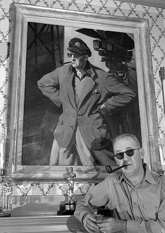 John Ford - John Ford with portrait and Oscar, circa 1946