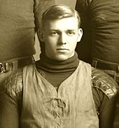 A man in an old football uniform