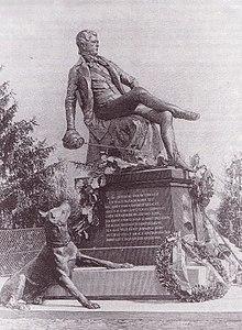 Mémorial au jeune Bismarck du Kösener Senioren-Convents-Verband à Rudelsburg (1896), qui est une statue Bismarck assis avec un chien à ses pieds