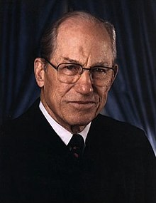 Byron White, in his Supreme Court attire, poses for a headshot.