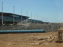 The passenger terminal under construction on August 28, 2009, taken from the airside and showing the domestic airbridges