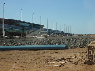 King Shaka International Airport - The passenger terminal under construction on 28 August 2009, taken from the air side and showing the domestic airbridges