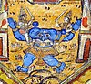 a blue monster without a head and with a big face on his chest. Two men holding swords seated on his two arms