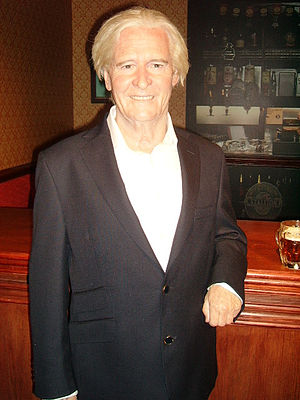 Ken Barlow standing at the bar of the Rovers R...