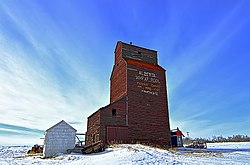 Former Kingman Alberta Wheat Pool elevator. Now located on a private farm south of Kingman.